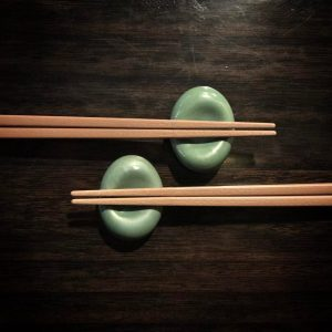 Tapered plastic chopsticks and rests with wooden finishing